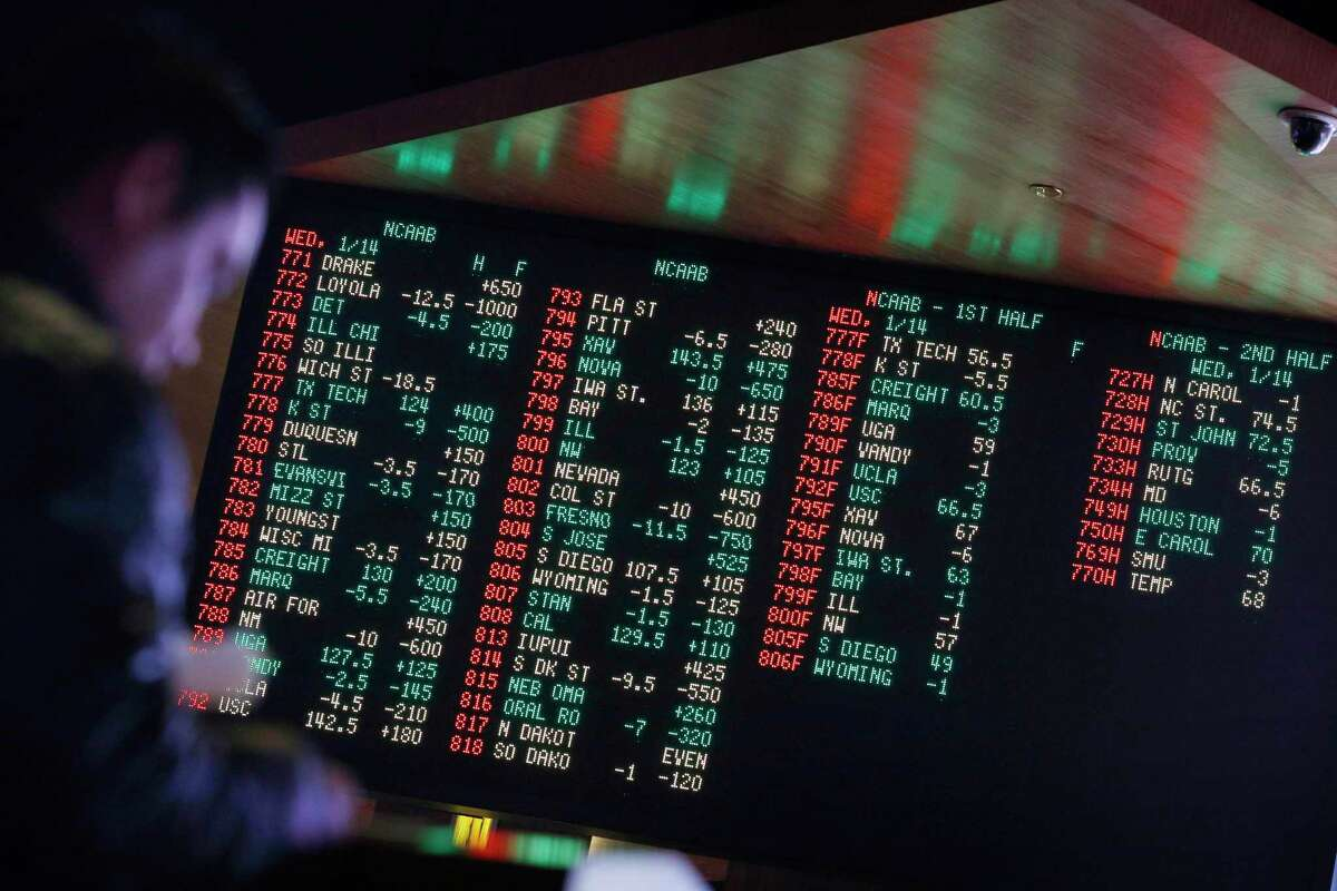 FILE - In this Jan. 14, 2015, file photo, odds are displayed on a screen at a sports book owned and operated by CG Technology in Las Vegas. More than a third of U.S. states are considering legalizing sports gambling if the Supreme Court overturns a federal law that has banned sports books in all but Nevada and three other states since 1992. (AP Photo/John Locher, File)