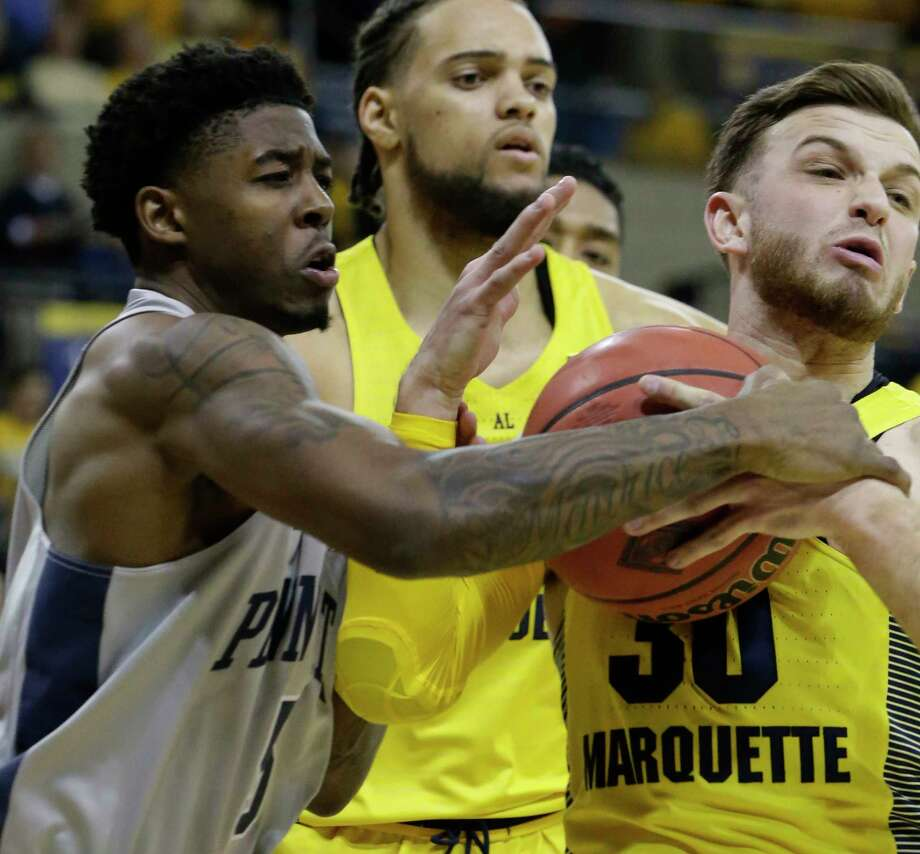 Penn State guard Jamari Wheeler (5) and Marquette guard Andrew Rowsey (30) tussle for a rebound during the first half of an NCAA college basketball game in the NIT on Tuesday, March 20, 2018, in Milwaukee. (Mark Hoffman/Milwaukee Journal-Sentinel via AP) Photo: Mark Hoffman / Milwaukee Journal Sentinel