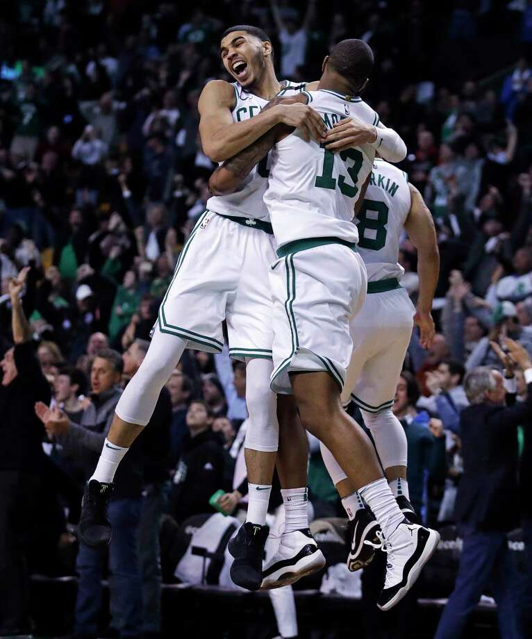 Boston Celtics forward Marcus Morris (13) leaps into the arms of teammate Jayson Tatum as they celebrate Morris' game-winning 3-point shot in the team's NBA basketball game against the Oklahoma City Thunder in Boston, Tuesday, March 20, 2018. The Celtics won 100-99. (AP Photo/Charles Krupa) Photo: Charles Krupa / Copyright 2018 The Associated Press. All rights reserved.