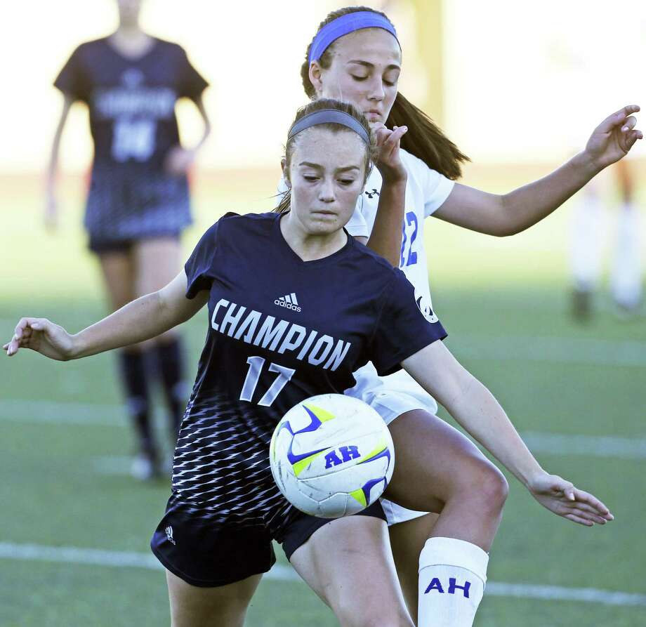 Charger's player Caitlin Canada controls against Izzy Flores as Alamo Heights hosts Champion in grils soccer at Orem Stadium on March 20, 2018. Photo: Tom Reel, Staff / San Antonio Express-News / 2017 SAN ANTONIO EXPRESS-NEWS
