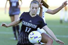 Charger's player Caitlin Canada controls against Izzy Flores as Alamo Heights hosts Champion in grils soccer at Orem Stadium on March 20, 2018.
