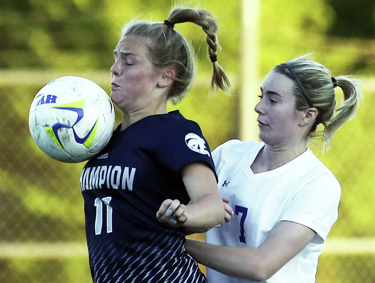Champion's Erika Wilson controls in front of Kinsley Sellers as Alamo Heights hosts Champion in grils soccer at Orem Stadium on March 20, 2018.
