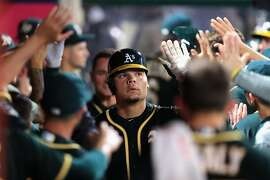 ANAHEIM, CA - AUGUST 30:  Bruce Maxwell #13 of the Oakland Athletics is congratulated in the dugout after hitting a two-run homerun during the seventh inning of a game against the Los Angeles Angels  at Angel Stadium of Anaheim on August 30, 2017 in Anahe