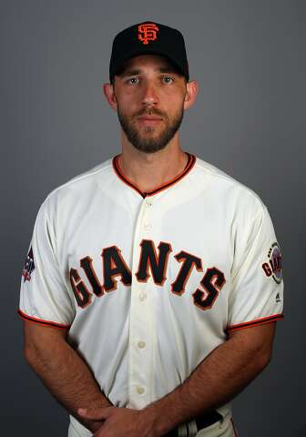 176636ac Giants' Madison Bumgarner fractures pitching hand after being hit by ...