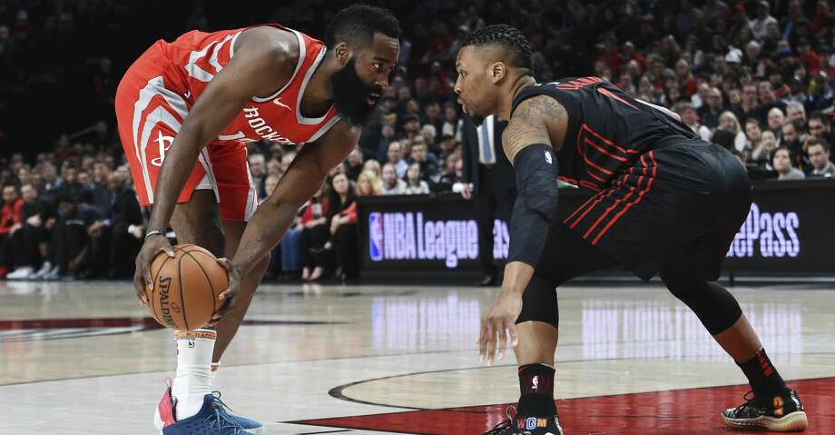Houston Rockets guard James Harden looks to get past Portland Trail Blazers guard Damian Lillard during the first half of an NBA basketball game in Portland, Ore., Tuesday, March 20, 2018. (AP Photo/Steve Dykes) Photo: Steve Dykes/Associated Press