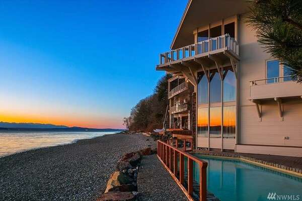This contemporary offers 100 feet of Puget Sound waterfront. Architect Ralph Anderson built in the early 60s for his own family; yours could be the new owner for $1.950M