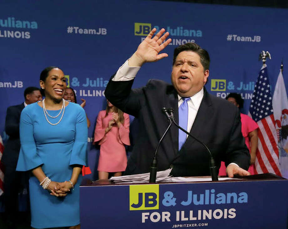 Democratic gubernatorial candidate J.B. Pritzker, right, celebrates winning the Democratic gubernatorial primary with lieutenant governor candidate Juliana Stratton, Tuesday, March 20, 2018, in Chicago. Photo: Charles Rex Arbogast | AP