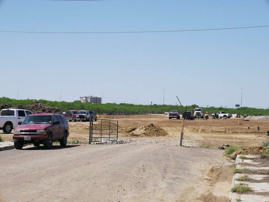 Crews work on a home development off Monaco Drive on Tuesday. The contractors involved in the project pushed past a 20-foot easement they were granted, and bulldozed 45-foot-wide swaths of wilderness in a few areas, an extra 0.58 acres of land, according to city records. Photo: Cuate Santos /Laredo Morning Times / Laredo Morning Times