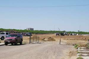 Crews work on a home development off Monaco Drive on Tuesday. The contractors involved in the project pushed past a 20-foot easement they were granted, and bulldozed 45-foot-wide swaths of wilderness in a few areas, an extra 0.58 acres of land, according to city records.