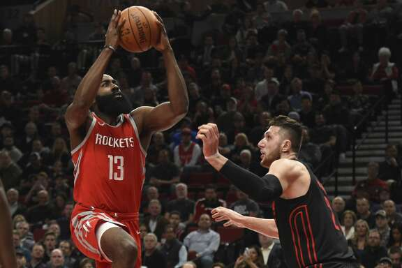 Houston Rockets guard James Harden drives to the basket on Portland Trail Blazers center Jusuf Nurkic during the first half of an NBA basketball game in Portland, Ore., Tuesday, March 20, 2018. (AP Photo/Steve Dykes)