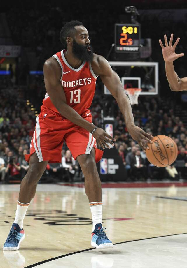 PHOTOS: A look at the Rockets' win in Portland on Tuesday nightHouston Rockets guard James Harden passes the ball during the first half of an NBA basketball game against the Portland Trail Blazers in Portland, Ore., Tuesday, March 20, 2018. (AP Photo/Steve Dykes) Photo: Steve Dykes/Associated Press