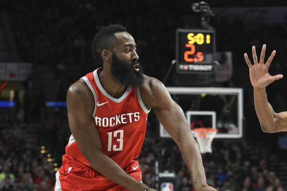 Houston Rockets guard James Harden passes the ball during the first half of an NBA basketball game against the Portland Trail Blazers in Portland, Ore., Tuesday, March 20, 2018. (AP Photo/Steve Dykes)