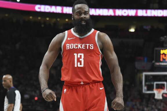 Houston Rockets guard James Harden reacts after making a play during the second half of the team's NBA basketball game against the Portland Trail Blazers in Portland, Ore., Tuesday, March 20, 2018. The Rockets won 115-111. (AP Photo/Steve Dykes)
