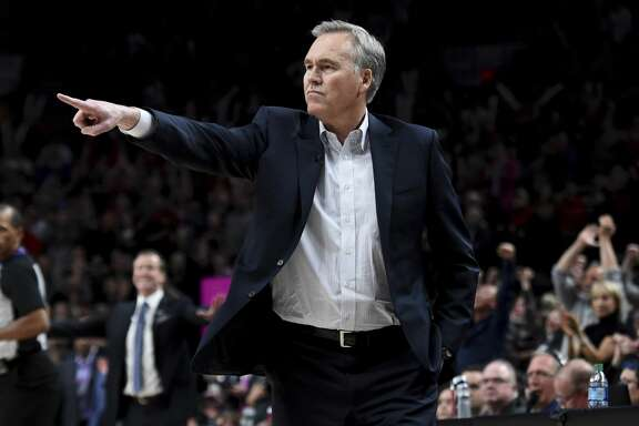 Houston Rockets coach Mike D'Antoni gestures during the second half of the team's NBA basketball game against the Portland Trail Blazers in Portland, Ore., Tuesday, March 20, 2018. The Rockets won 115-111. (AP Photo/Steve Dykes)