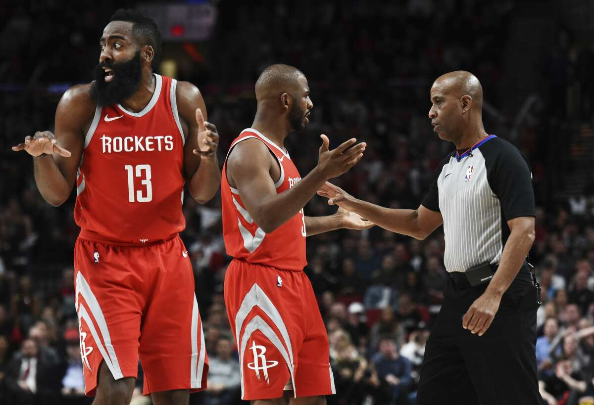 Houston Rockets guard James Harden reacts as guard Chris Paul argues a call with referee Derrick Stafford during the second half of the team's NBA basketball game against the Portland Trail Blazers in Portland, Ore., Tuesday, March 20, 2018. The Rockets won 115-111. (AP Photo/Steve Dykes)