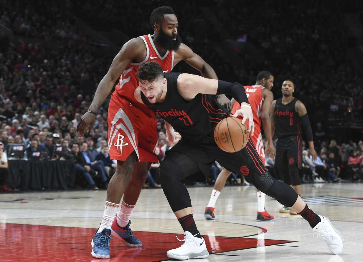 Portland Trail Blazers center Jusuf Nurkic is fouled as he drives to the basket on Houston Rockets guard James Harden during the second half of an NBA basketball game in Portland, Ore., Tuesday, March 20, 2018. The Rockets won 115-111. (AP Photo/Steve Dykes)