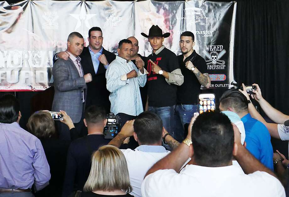 "Laredo's Rodolfo Gomez Jr. (12-4-1, 8 KOs), center right, will fight veteran boxer Ricardo Mayorga (30-10-1, 26 KOs) of Nicaragua in the headliner of the ""Battle of the Borderland 1"" Showdown at Laredo Energy Arena on April 7. Photo: Cuate Santos /Laredo Morning Times / Laredo Morning Times"