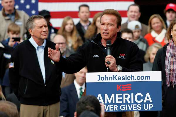 FILE - In this March 6, 2016, file photo, former California Gov. Arnold Schwarzenegger introduces Republican presidential candidate, Ohio Gov. John Kasich during a campaign rally in Columbus, Ohio. Can California's faded Republican Party make a comeback? Schwarzenegger will take up that question Wednesday, March 21, 2018, at an event in Los Angeles organized by a group that hopes to move the GOP in a new direction in the age of President Donald Trump. He'll be joined by another Republican centrist, Kasich, who was a Trump rival in the 2016 presidential campaign.
