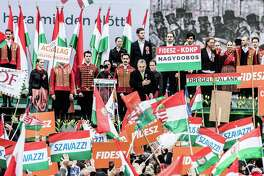 Hungarian Prime Minister Viktor Orban (center) acknowledges the crowd during a public ceremony in Budapest, Hungary, on March 15, 2018.