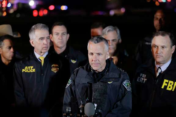 Austin Police Chief Brian Manley, center, stands with other members of law enforcement as he briefs the media, Wednesday, March 21, 2018, in the Austin suburb of Round Rock, Texas. The suspect in a spate of bombing attacks that have terrorized Austin over the past month blew himself up with an explosive device as authorities closed in, the police said early Wednesday.