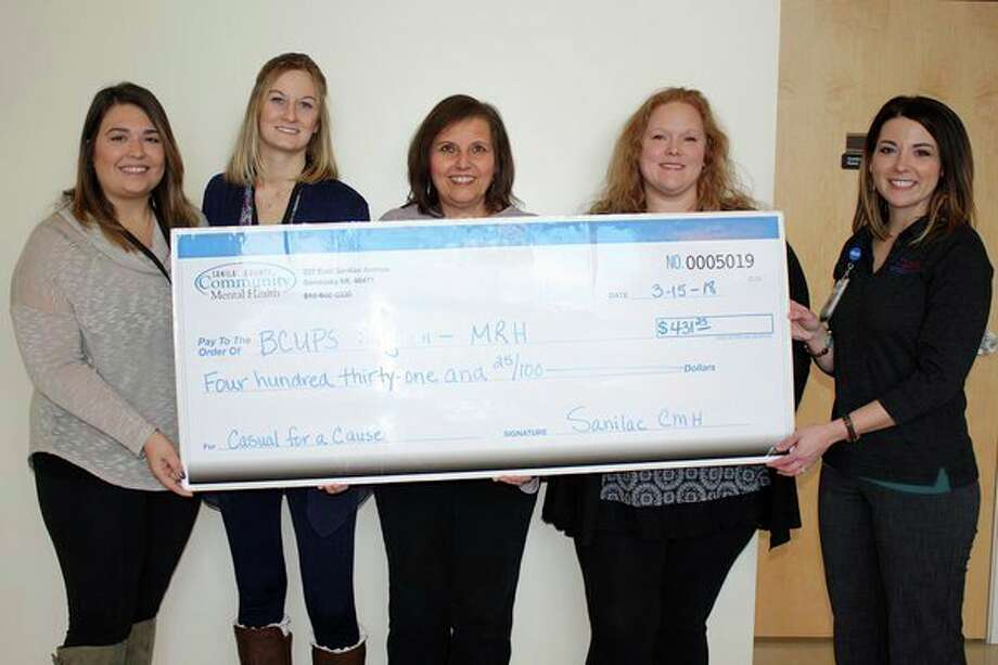 Marlette Regional Hospital MRH Foundation Manager Sara Redman (right) recently presented a check to Lisa Smigill, Jamie Siemen, Sheila Williams, and Sheila Hill, all of Sanilac County Community Mental Health. (Submitted Photo)