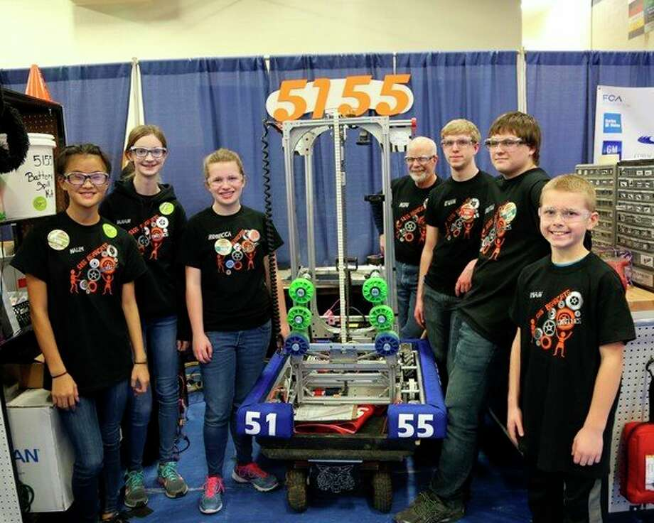 The Ubly Bearcat robotics team members include (from left): Haley Krueger, Sarah Peplinski, Rebecca Particka, Ken Murray, Evan Franzel, Christian Gezequel and Ryan McCarty. The team is posing with its robot -- The Blurr. (Submitted Photo)