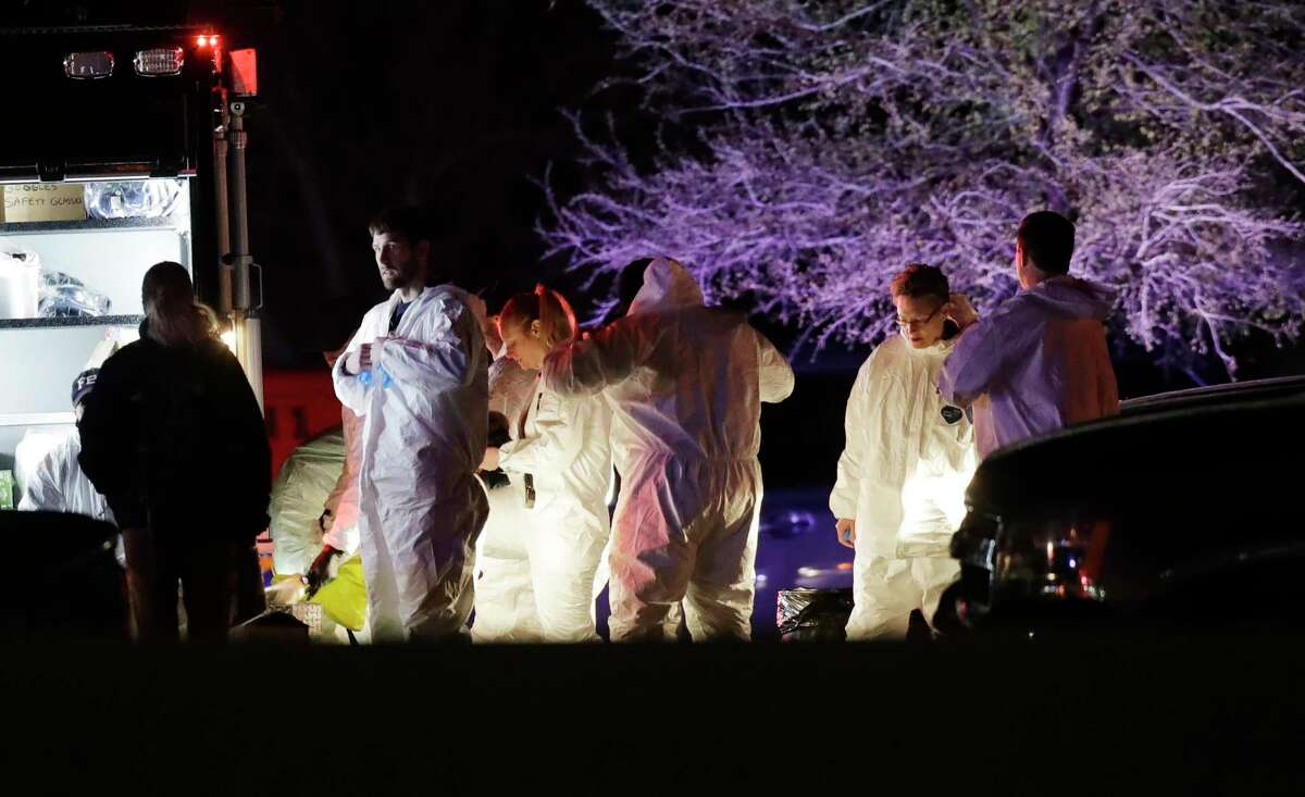 Members of law enforcement stage near the area where a suspect in a series of bombing attacks in Austin blew himself up as authorities closed in, Wednesday, March 21, 2018, in Round Rock, Texas.