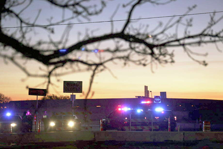 Law enforcement officers block the access road to I-35 south at Old Settlers Blvd in Round Rock, just north f where the suspect bomber killed himself, on Wednesday, March 21, 2018. Photo: Bob Owen, San Antonio Express-News / San Antonio Express-News