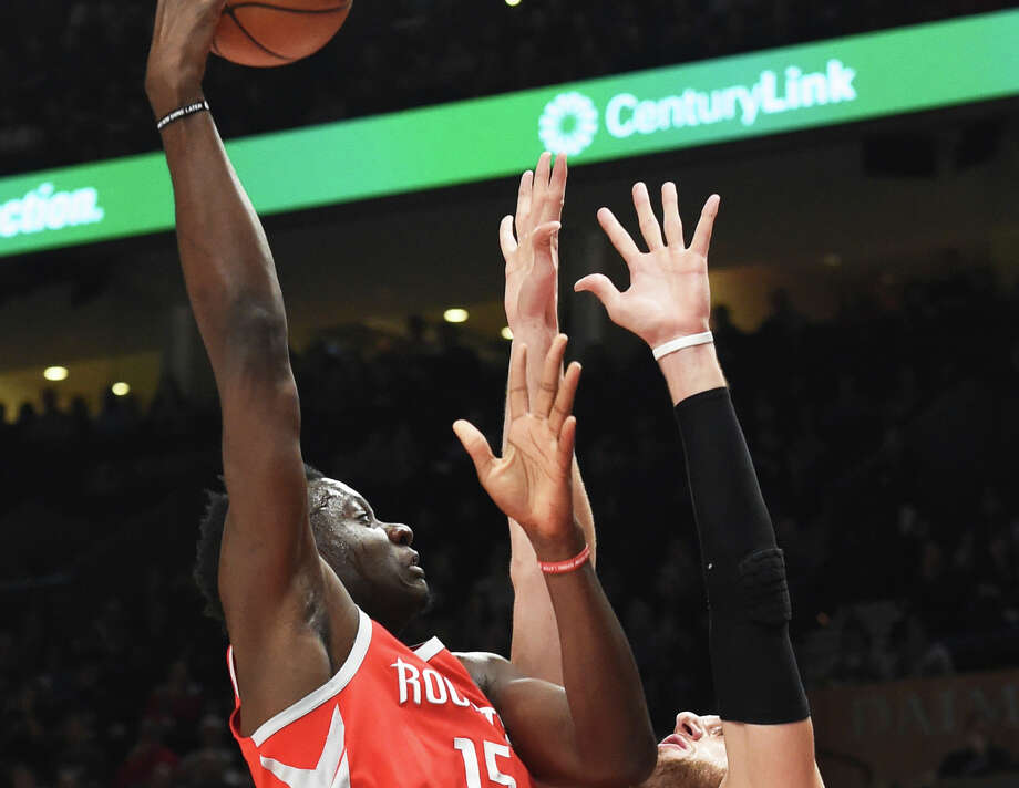 Houston Rockets center Clint Capela shoots the ball over Portland Trail Blazers center Jusuf Nurkic during the first half of an NBA basketball game in Portland, Ore., Tuesday, March 20, 2018. (AP Photo/Steve Dykes) Photo: Steve Dykes/Associated Press