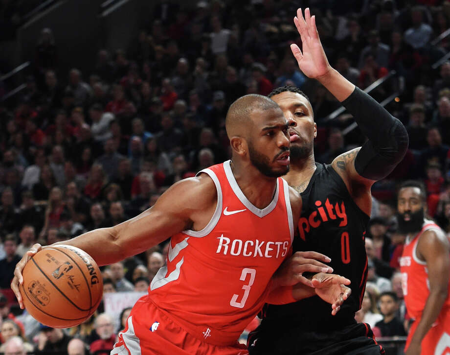 Houston Rockets guard Chris Paul drives to the basket on Portland Trail Blazers guard Damian Lillard during the first half of an NBA basketball game in Portland, Ore., Tuesday, March 20, 2018. (AP Photo/Steve Dykes) Photo: Steve Dykes/Associated Press