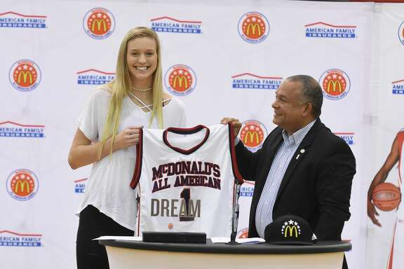 Catherine Reese received honors as a McDonald All American basketball player from Ramon Bolivar, the McDonald Awards program director, at Cy Woods High School.Catherine Reese received honors as a McDonald All American basketball player from Ramon Bolivar, the McDonald Awards program director, at Cy Woods High School.
