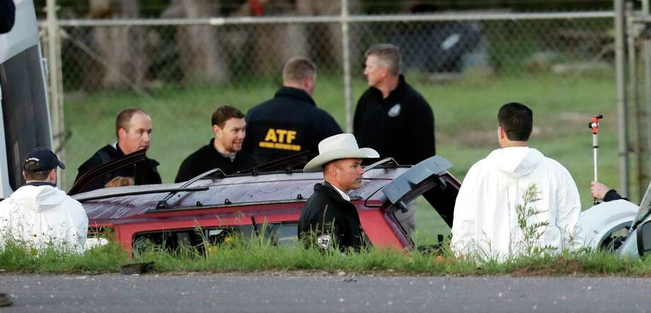 Officials investigate the scene where a suspect in a series of bombing attacks in Austin blew himself up as authorities closed in, Wednesday, March 21, 2018, in Round Rock, Texas. Photo: Eric Gay, AP / Copyright 2018 The Associated Press. All rights reserved.