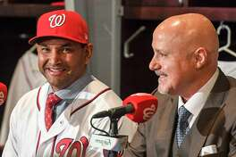 Washington Nationals GM Mike Rizzo introduces Dave Martinez as their new manager on Nov. 2,2017, in Washington.