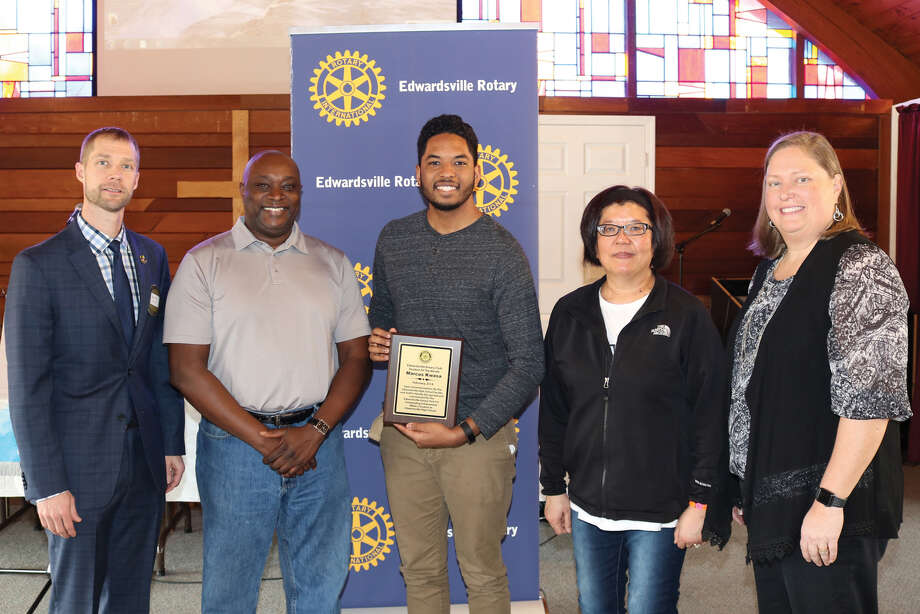Edwardsville Rotary Student of the Month Marcus Kwasa, center, receives his plaque. Photo: For The Intelligencer