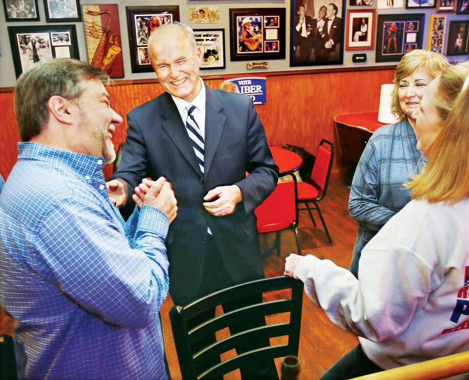 Democratic candidate for Illinois Governor, Bob Daiber, center, shares a laugh with well-wishers after the polls closed Tuesday night at Donzo's Bar on East Ferguson Avenue in downtown Wood River. A group of family and friends gathered for a watch party at the establishment to monitor the primary race. There appeared to be a low voter turnout despite there being six Democrats and two Republicans running to be their party's choice for governor in the November general election. Photo: John Badman • For The Intelligencer