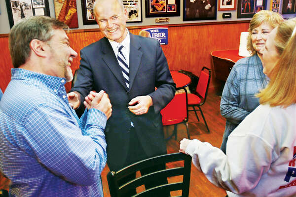 Democratic candidate for Illinois Governor, Bob Daiber, center, shares a laugh with well-wishers after the polls closed Tuesday night at Donzo's Bar on East Ferguson Avenue in downtown Wood River. A group of family and friends gathered for a watch party at the establishment to monitor the primary race. There appeared to be a low voter turnout despite there being six Democrats and two Republicans running to be their party's choice for governor in the November general election.