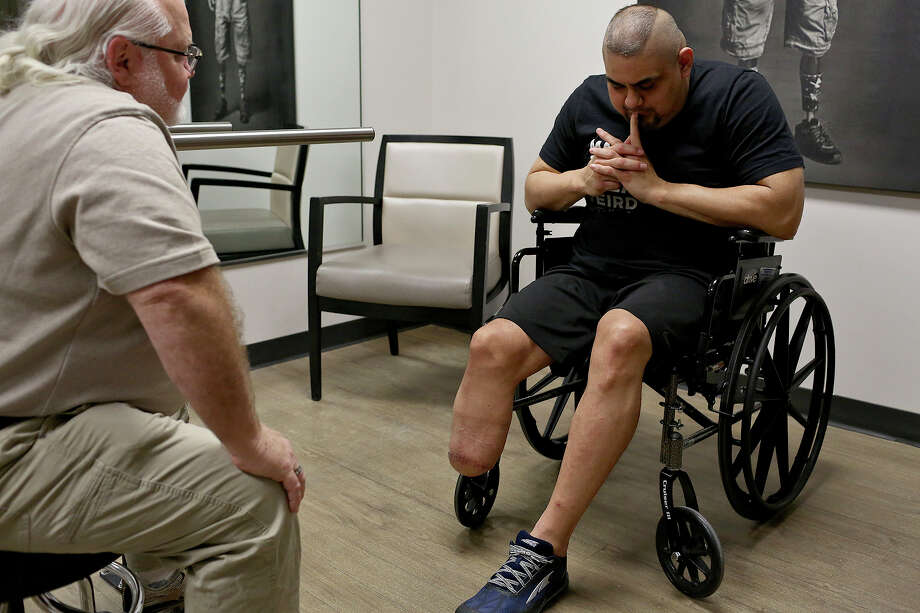 Isaac Rodriguez talks with prosthetist Randy Farley during his first consultation with Farley at Hanger Clinic in San Antonio. Photo: SAN ANTONIO EXPRESS-NEWS / SAN ANTONIO EXPRESS-NEWS