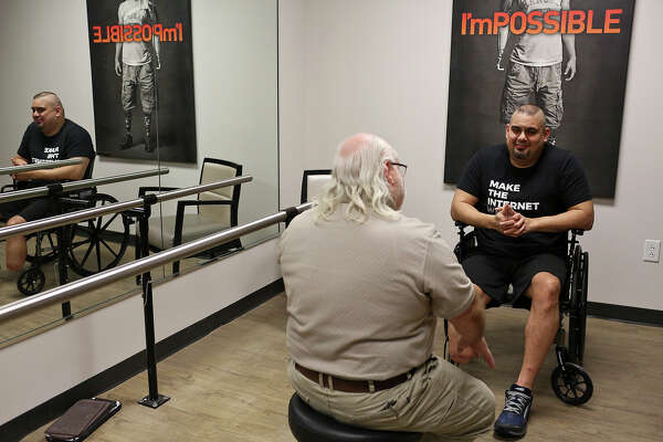 Isaac Rodriguez talks with prosthetist Randy Farley during his first consultation with Farley at Hanger Clinic in San Antonio on Tuesday, March 20, 2018.
