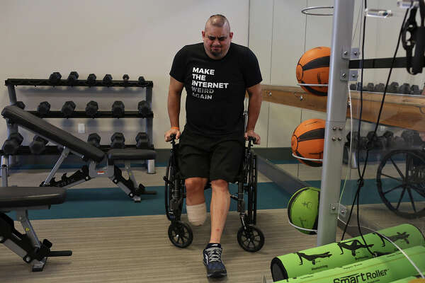 Isaac Rodriguez does tricep dips using his wheelchair as he exercises in his apartment complex's gym in San Antonio on March 12, 2018.