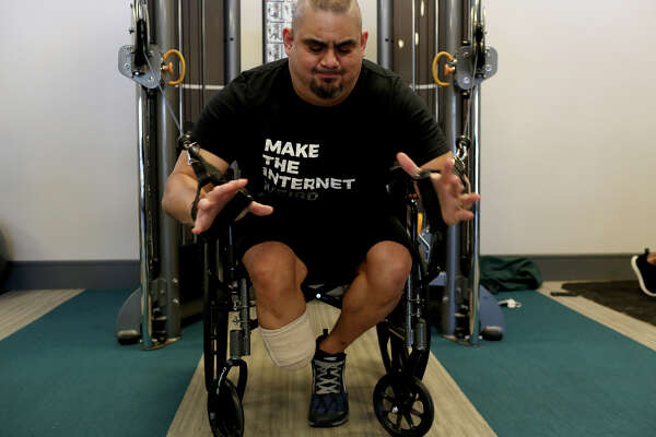 Isaac Rodriguez does strength work at his apartment complex's gym in San Antonio on March 12, 2018.