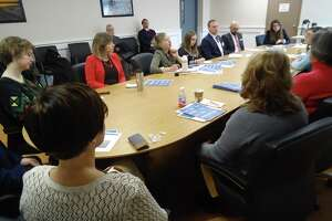 The Devon Rotary Club in Milford is hosting a delegation of six government officials from Ukraine. They're in Milford this week to learn how local, state and national government operations work in the United States. Here, they're listening to a presentation from several local officials in the Parsons Government Building in Milford, Conn. on Tuesday, March 20, 2018.