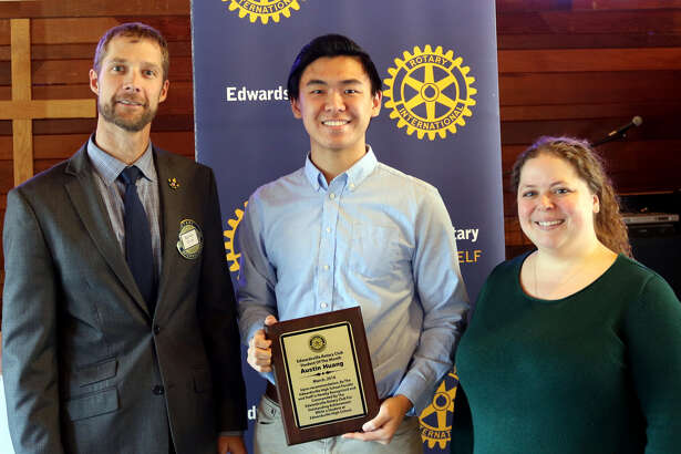 Austin Huang, center, receives the Edwardsville Rotary Club's Student of the Month Award.