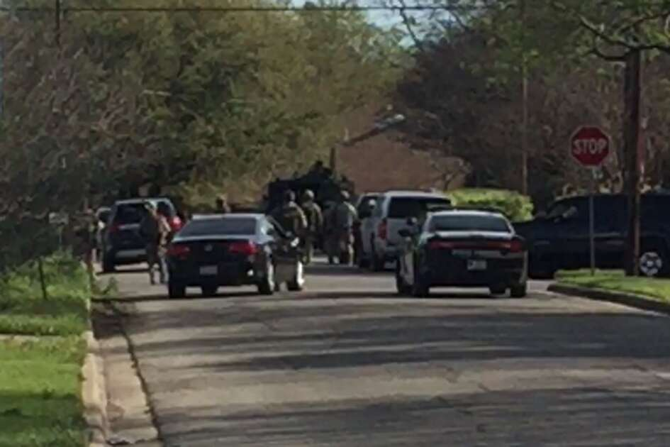 Officers with the Bureau of Alcohol, Tobacco, Firearms and Explosives and the Texas Department of Public Safety swarm a neighborhood in Pflugerville on Wednesday, March 21, 2018, where they believe the suspected bomber was living.