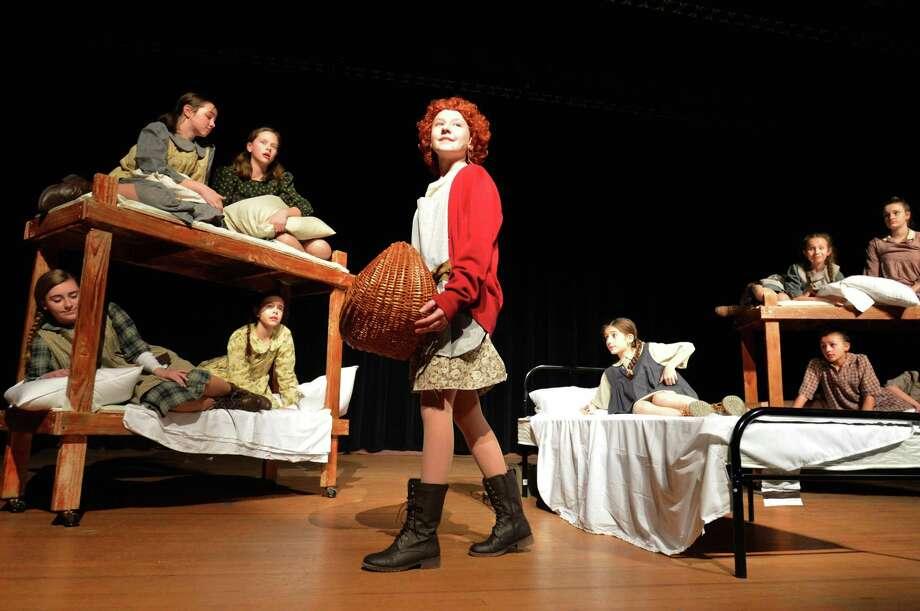 "Rachel Boone as Annie runs away from the orphanage in West Rocks Middle School's spring production of ""Annie Jr."" Photo: Alex Von Kleydorff / Hearst Connecticut Media / Norwalk Hour"