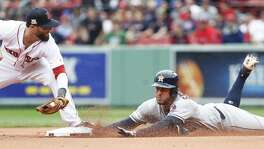 Houston Astros center fielder George Springer (4) slides safely under the tag of Boston Red Sox second baseman Dustin Pedroia for a double during the first inning of Game 4 of the ALDS at Fenway Park on Monday, Oct. 9, 2017, in Boston. ( Karen Warren / Houston Chronicle )