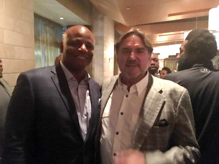 Quarterbacks Warren Moon and Dan Pastorini at the Houston Oilers reunion dinner.