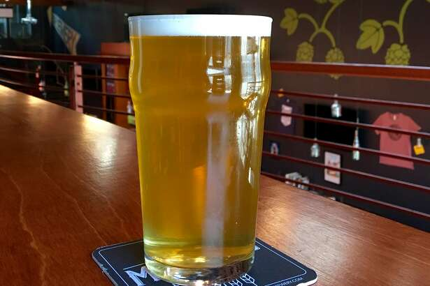 Social Brewing's Kim Sturdavant is widely credited with pioneering the beer style. Pictured is one of its brut IPAs, Puttin' on the Spritz.