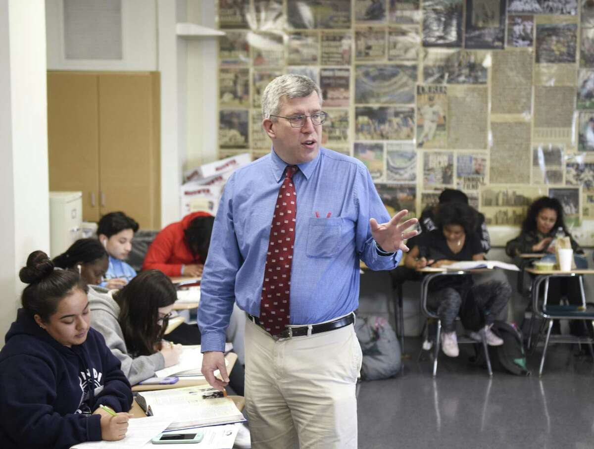 Doug MacLehose teaches a U.S. history class at Stamford High School in Stamford, Conn. Thursday, March 15, 2018. MacLehose often focuses on immigration in his history classes taught at Stamford High, which has a large percentage of first- and second-generation immigrants.
