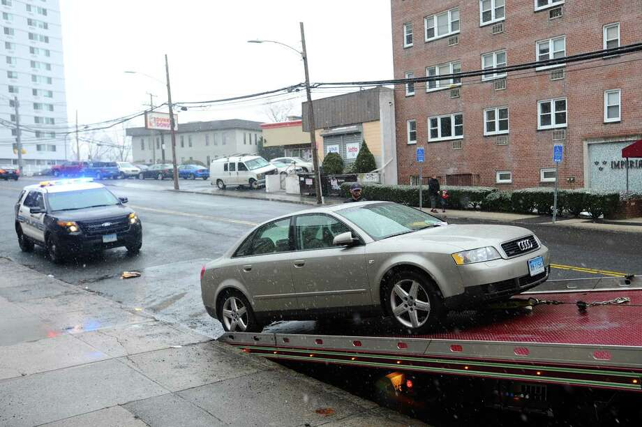 A car which was illegally parked in a tow-away snow zone gets towed in downtown Stamford, Conn.  Photo: Michael Cummo, Hearst Connecticut Media / Stamford Advocate