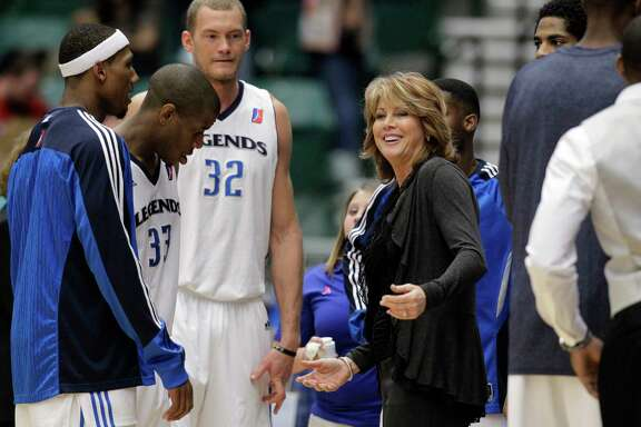 In this photo taken Wednesday, March 30, 2011, Texas Legends head coach Nancy Lieberman, center, reacts as she tries to get the attention of one of her players during an NBA Development League basketball game against the Springfield Armor in Frisco, Texas. (AP Photo/Tony Gutierrez)
